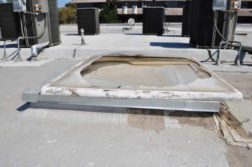 This photo shows the unguarded and unprotected skylight that was not strong enough to support Mr. Recio's weight and, consequently, he fell right through the roof. (PRNewsFoto/Robinson Calcagnie Robinson Sha)